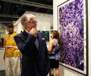 rich person looking at expensive artwork