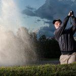 guy playing golf