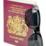 passport and sunglasses