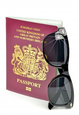 passport and sunglasses, all part of the travelling addiction