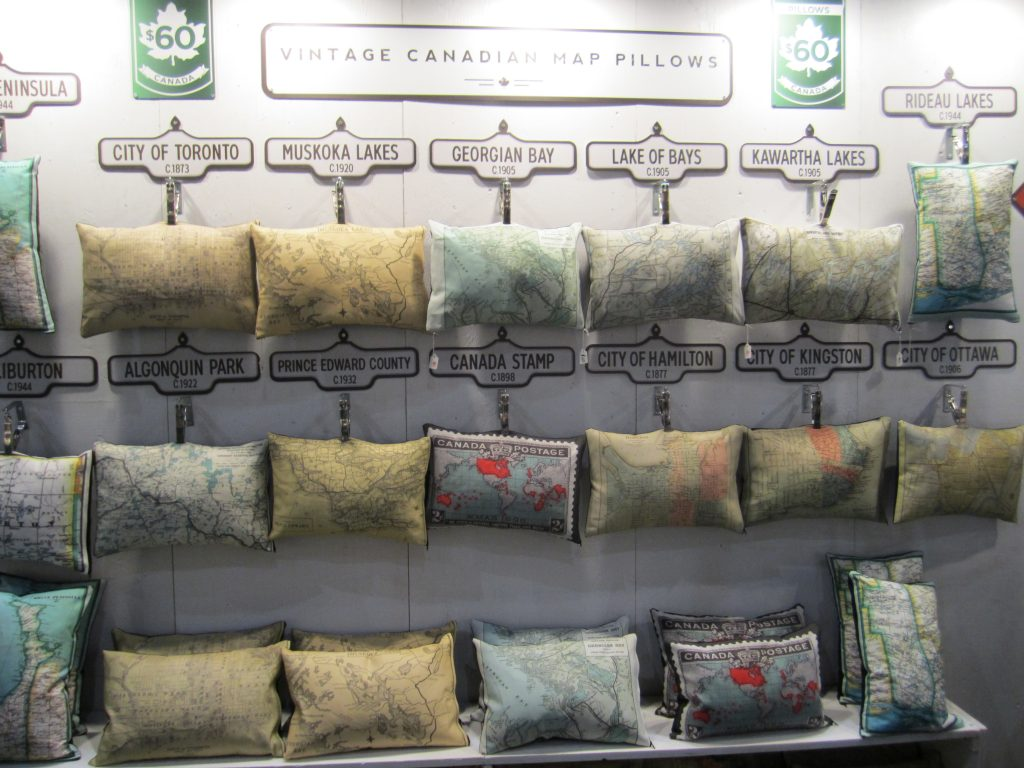 handmade vintage map pillows at the one of a kind show